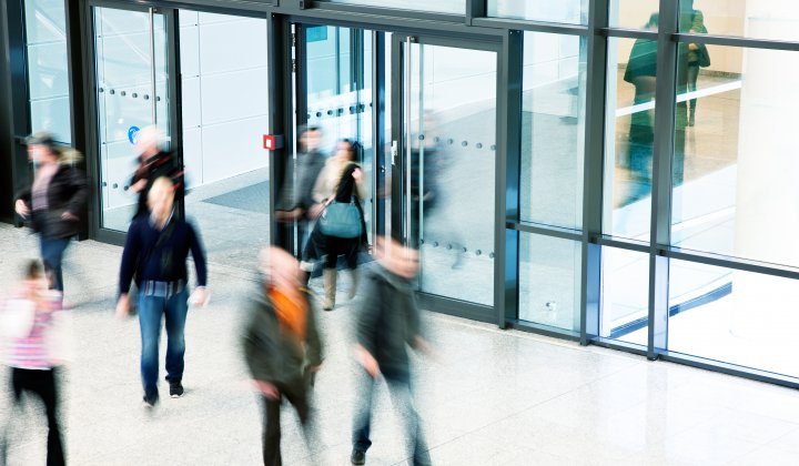 People moving through a building entrance quickly